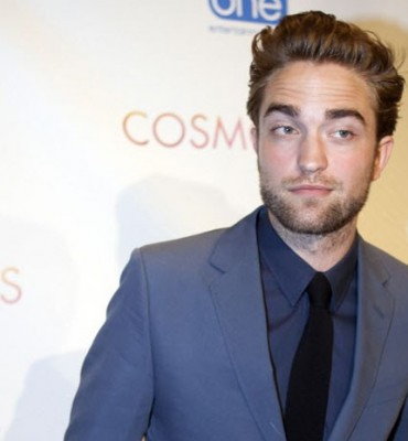 A bearded Robert Pattinson
