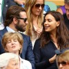 Bradley Cooper and Irina Shayk watch the Men's Singles Final match of the Wimbledon Tennis Championships on July 10, 2016 in London, England.