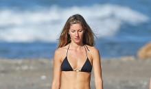 Gisele Bündchen is one hot momma in her tiny black bikini