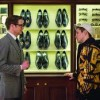 """Kingsman: The Secret Service"" (20th Century Fox): Colin Firth shows off the different spy gadgets to recruit Taron Egerton."