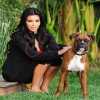 Kim Kardashian poses a photo with her beloved dog, Rocky