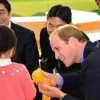 Prince William Plays with a Japanese Kid While Prime Minister Shinzo Abe Looks On