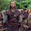 Chris Hemsworth as the Huntsman with his friendly dwarves